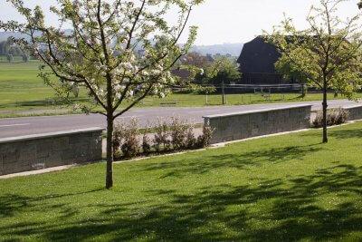 Gartenbegrenzungen mit Trockenmauern